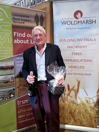 Mr Michael Parker- collecting the prize for the winner of the Ladies Points Competition on behalf of Carol Keene