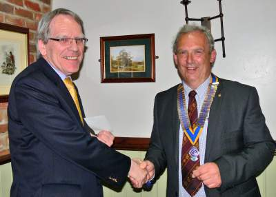 LRSN's Richard Alderson recieving a cheque for £500 from Brigg Rotary's outgoing President Nick Wells