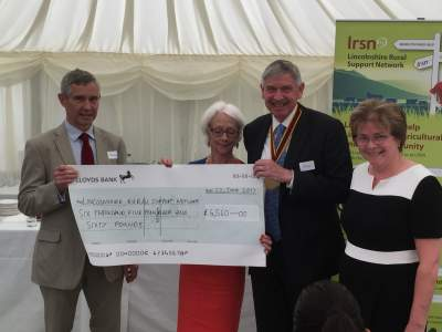 Philip Wynn, Master of the Worshipful Company of Farmers presenting a cheque for the sum of £6560 to LRSN