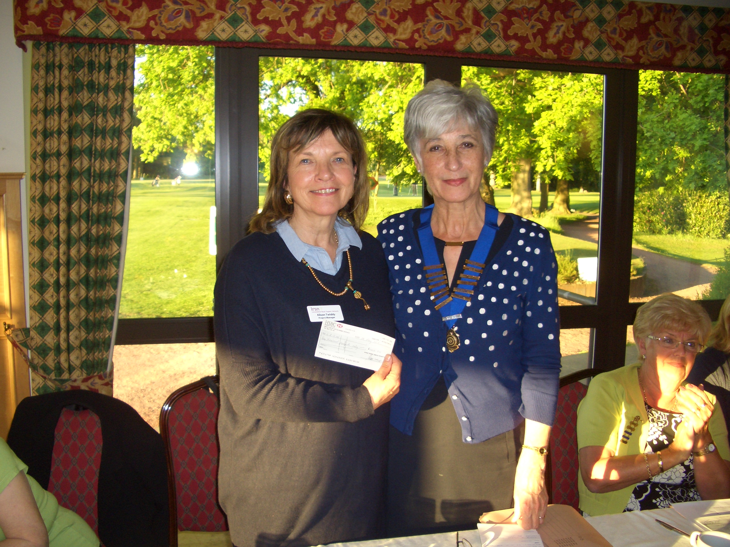 Alison Twiddy, on the left, receiving a cheque for £1000 from the Brigg Inner Wheel Club President, Lesley Alderson
