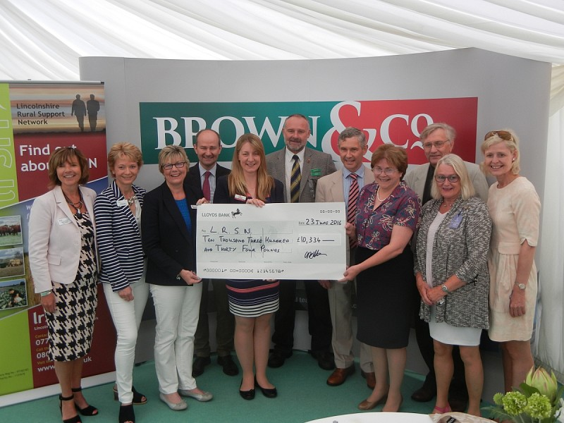 The LRSN team receiving a cheque for the sum of £10,334 from proceeds of the Lincolnshire Rural Charities Dinner