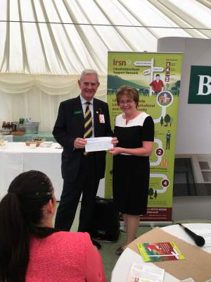 Ambrose Fowler, former President of Brigg Rotary, presenting a cheque for the sum of £1487 to LRSN